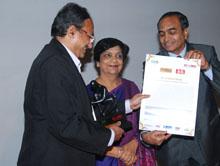 Dr Baliga (left) receiving his award