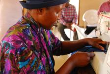 Members of the Maliyadma support group make school uniforms for orphans.  Many of the group are grandparents caring for children who have lost their parents to AIDS.  Maliyadma is a member of SWANNEPHA.